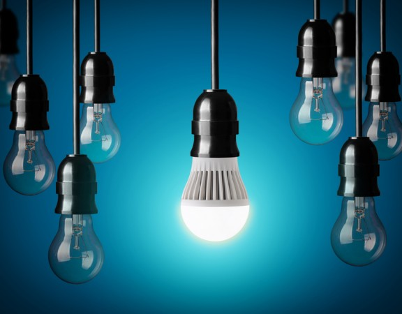 LED bulb and simple light bulbs. Blue background